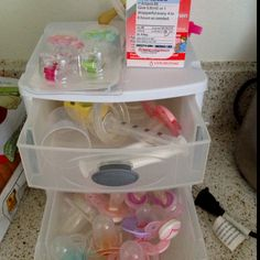 baby drawers for kitchen.  pacifiers, med syringe, paci clips, ect.