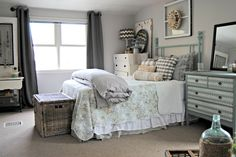 Use subtle wall colors like this pale grey bedroom.
