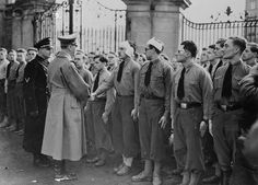 Adolf Hitler Shaking Hands with German Students - U495139ACME - Rights Managed - Stock Photo - Corbis. Original caption:Hitler Consoles Germans Wounded at Prague. Prague, Czechoslovakia: At the head of the receiving line in Hradcany Castle, shrine of Czech heroes of the past, Chancellor Adolf Hitler (foreground) shakes hands with German students wounded in riots attending Nazi occupation of Prague and other sections of Czech and Slovak territory. March 23, 1939