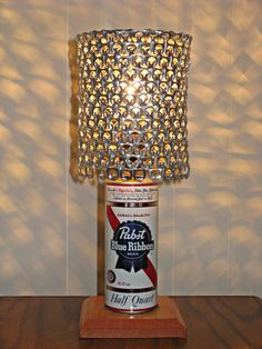 Here is a lamp that I made using a vintage recycled Pabst Blue Ribbon beer can. The lamp shade is constructed using recycled beer can tabs ...