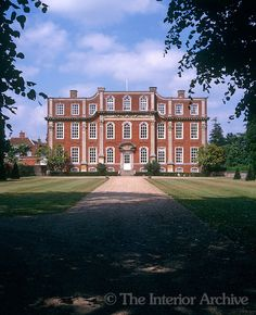 The garden facade of Chicheley Hall which was built by Francis Smith in the early 18th century is decorated with Corinthian pilasters and a finel carved frieze