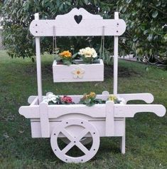 I'm thinking about switching my wishing well out for this. A change of scenery. Wooden Planters, Outdoor Planters, Planter Boxes, Landscape Timber Crafts, Landscape Timbers, Wooden Projects, Outdoor Projects, Wood Crafts, Flower Cart