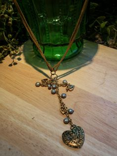 found objects upcycled into a Golden Heart Drop Boho leather chain Necklace by Changedidentity