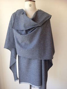 Gray Cashmere Cape - Wool Cashmere Poncho Mens Cape - Ladies Winter Ponchos - Grey Winter Coat Ponchos Cape Plus Size Clothing - Made in UK  Soft grey cashmere and wool poncho Wear it over a coat or a sweater Warm and super stylish fashion for this winter Unisex style! for Men or Women One Size Measuring when worn 115cm width, 80 cm length Made in England 80%wool 20%cashmere  Dry Clean Only Perfect Gift Item *for custom orders and wholesale enquiries please send me a message I can make…