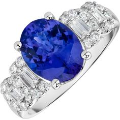 This stylish design boasts a tantalizing tanzanite (2.62 ctw), accented by sparkling round and baguette-cut diamonds (.53 ctw), set in a pristine 14k white gold ring.