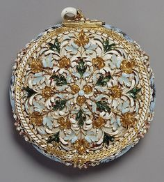 The decoration of this elaborately jeweled pocket watch includes a depiction of the young Louis XIV on horseback and a miniature with the arms of France and Navarre and the Orders of Saint Michael and the Holy Spirit. 1645-1648