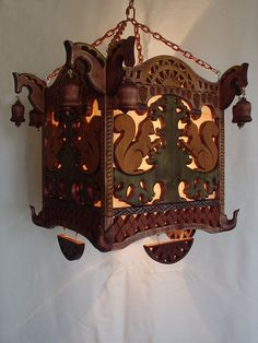 Carved pendant light from a natural tree, decorated with bells