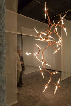 Lindsay Adelman · Custom Agnes Swarm with 40 bulbs in brushed copperShown at ICFF 2014Photos by Lauren Coleman