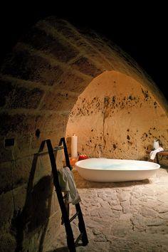 Sextantio Le Grotte della Civita - Matera, Italy - Many bathrooms are placed in naturally-occurring alcoves.