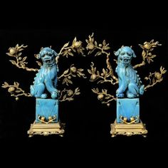 Chinoiserie - Foo Dogs- just a little maniacal looking-love te color and branches, of course