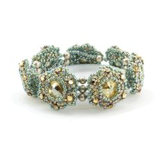 This is our version of the 60's flower power motif. What are 3 things people love about this bracelet? 1) It's seamless when worn. 2) The puffy flowers are super sparkly. 3) It is fast and easy to do!