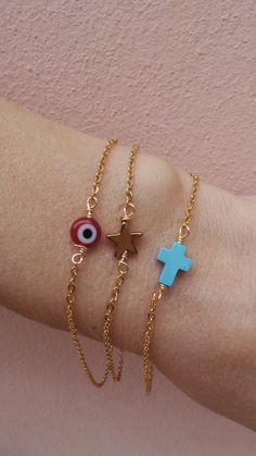 Tiny charm bracelet. Little charm bracelet.Sideways cross bracelet. Little star bracelet. Evil eye bracelet. Gold charm bracelet.