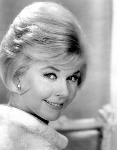 """Doris Day is an American actress, singer, and animal rights activist. Day began her career as a big band singer in 1939. Her popularity began to rise after her first hit recording """"Sentimental Journey"""", in 1945."""