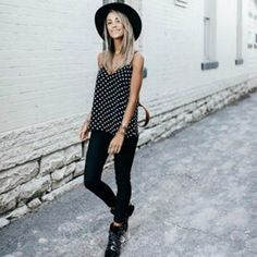 @meg_legs wears a cute black and white polka dot cami with black skinnies for a smart causal style which we love. She accessorises this look with a wide brimmed fedora hat and pairs the overall style with chunky boots. Shoes: #givenchy , Top: #revolve . https://www.justthedesign.com/outfits-with-black-jeans/ #fashion, #fashionista, #fashionblogger, #streetstyle, #fashionicon, #instastyle, #instafashion