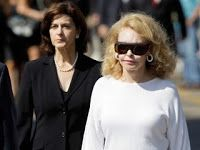 Ted Kennedy's first wife Joan Bennett Kennedy walks with his second wife Victoria Reggie Kennedy during the days of his wake and funeral