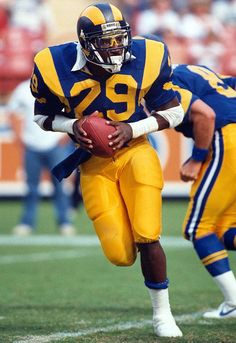 "NFL & Rams Record: Eric Dickerson (""The Great ED"") rushed for an NFL record yards in Nobody has beaten him yet.closest was Adrian Peterson of the Vikings, I think. TOP 1 league of legends player Football Uniforms, Football Memes, Sport Football, Football Players, School Football, Football Stuff, School Sports, Sports Teams, American Football"