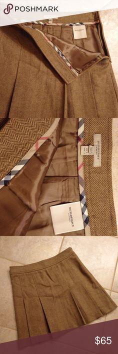 Burberry Wool Tweed Pleated Mini Skirt Burberry London size 2, flawless condition. Pleated mini skirt, school girl style with hidden side zipper in a brown and tan herringbone tweed. 100% Wool, lined. Burberry Skirts Mini
