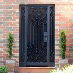 A unique wrought iron security entry door by Adoore Iron Designs located in Melbourne Australia. Wrought Iron Security Doors, Wrought Iron Doors, Window Grill Design, Door Design, Wrought Iron Handrail, Black Front Doors, Knobs And Knockers, Steel Doors, Black Accents