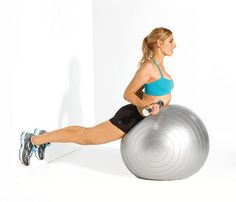Lie facedown with midsection on ball, feet anchored low on wall, a weight in each hand; lower arms in front of ball, palms facing ball. Lift chest off ball as you rotate palms up and pull elbows to sides, squeezing shoulder blades together (as shown). Return to start for 1 rep. Do 12 reps; repeat.