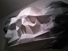 Massive 3D Puzzle-Like Sculpture Depicting Angular Faces Of Life And Death | The Creators Project
