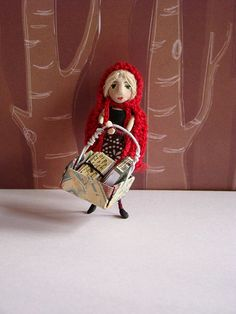 Little Red Riding Hood Matchbox Doll with big basket of things stuff for grandma. A small matchbox doll created for a fairy tale box swap on swap-bot. by Candyn of Flickr.