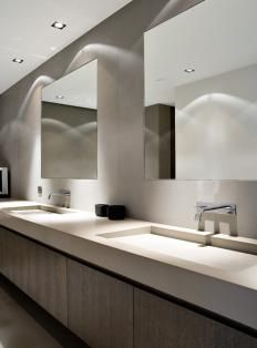 """Floating"" backlit mirrors in the bathroom"