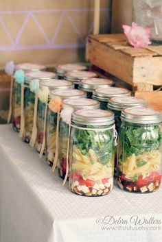 Mason jar salads at a rainbow pastel pom-pom party! See more party ideas at CatchMyParty.com!