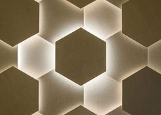 Joshua Florquin adds hexagonal-patterned ceiling to salon