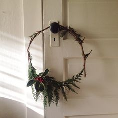 Petite Cedar wreath with variegated holly.