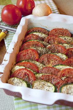 Tomato Zucchini Tian - layers of fresh tomatoes and zucchini over an eggplant and onion base scented with Herbes de Provence. Vegetable Tian, Vegetable Dishes, Side Recipes, Vegetable Recipes, Delicious Vegan Recipes, Healthy Recipes, Vegetarian Recipes, Yummy Food, Recipe For Split Peas