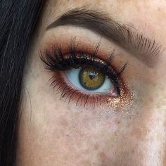 Highlight the inner corner of your eye with a little touch of copper glitter eyeshadow.