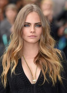 Best Celebrity Beauty Looks This Week  - Cara Delevingne with bold, brushed up brows and perfect wavy hair at Burberry