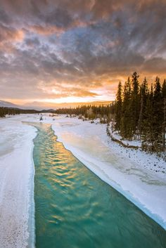 Sunrise at Winter river in the Canadian Rockies (Jasper, Alberta) by Taka - / 500px