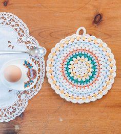Ravelry: Simple Folk Circle Potholder pattern, from Crochet Home by Emma Lamb