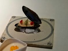 Tile with clam at restaurant De Kromme Watergang * *, The Netherlands.