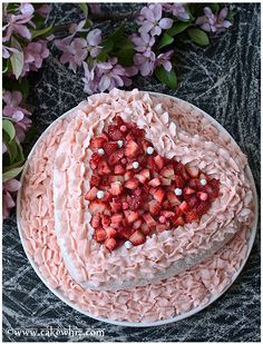 PINK VELVET CAKE filled and covered in silky smooth strawberry frosting and fresh strawberries. This cake tastes just as good as it looks! From cakewhiz.com