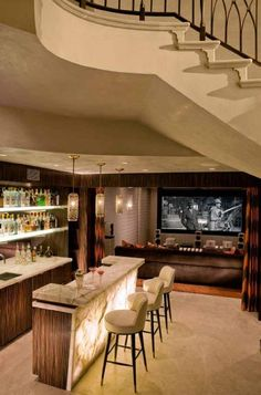 Movie theater and game room with billiards and a wet bar. Note how the lighting highlights the front of the seating area.