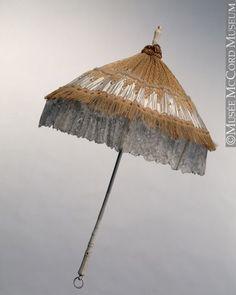 McCord Museum (unknown culture) brown silk parasol with heavy trim and lace on painted wooden handle, late Lace Umbrella, Lace Parasol, Vintage Umbrella, Under My Umbrella, Outdoor Patio Umbrellas, Umbrellas Parasols, 1870s Fashion, Victorian Fashion, All Black Dresses