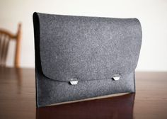 MacBook Pro with Retina Display Sleeve Case 15 inch Heritage Wool Felt and Leather Handcrafted. $95.00, via Etsy.