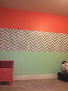 Coral, grey/white chevrons & mint. All painted by my hubby! Surrounding walls are grey.