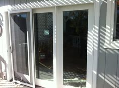 Novato Three Panel Door Replacement.  A customer's existing wood door was replaced with a Marvin Clad Ultimate Inswing French Door. The replacement with the Stone White Clad unit was a signigicant upgrade from the existing wood exterior door unit.