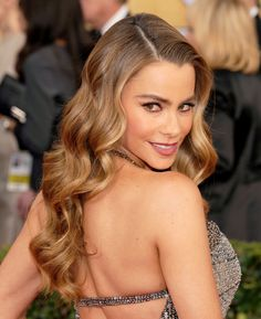 Leave it up to Sofia Vergara to prove just how sexy wavy hair looks. Give your hair a deep side part and big curls for the perfect big-statement look that works with any nighttime outfit. - GoodHousekeeping.com