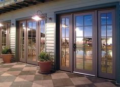 Three Panel Glass Doors With Side Panels That Open