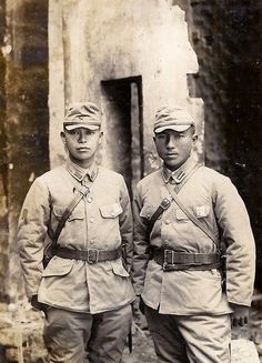 This is an old snapshot of two Japanese soldiers pausing for a brief moment during World War II for posterity. There is nothing written on the back to identify either of these men or to indicate exactly when or where the photograph was taken.