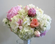 Bridal Bouquet ~ White Hydrangeas, Blush Pink Peonies, Light Purple Freesia, White & Pink Tulips, Pink Roses, Pink Spray Roses, & White Stock.  Created for a Tiffany Blue Wedding.