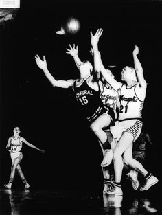 Photographer/Creator  Dean Conger  Collection  1955  Publisher  Denver Post  Caption/Description  Dan Frank, Cathedral pivotman, breaks away from a pack of St. Joseph's Bulldogs to pull down a loose ball in a Denver Parochial basketball league game at the auditorium arena.