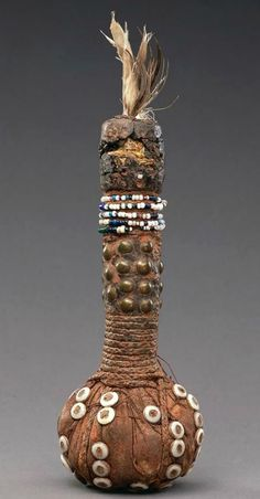 Africa | Vessel / bag from the Yombe people of Mayombe, Bas-Congo, DR Congo | Feather, vegetal fibre, metals and beads | ca. 1919