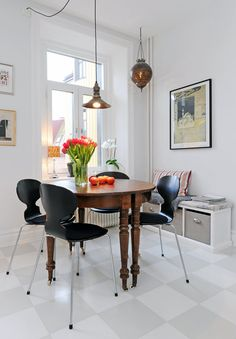 Antique table and modern chairs