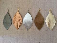 Metallic Leather Feather Earrings by SymposiumCo on Etsy