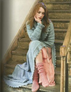 Dressing Gown is a wonderfully glamorous full-length dressing gown with a large shawl collar, lace edging and a tie fastening.  Knitted in